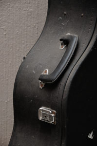 close up of old guitar case