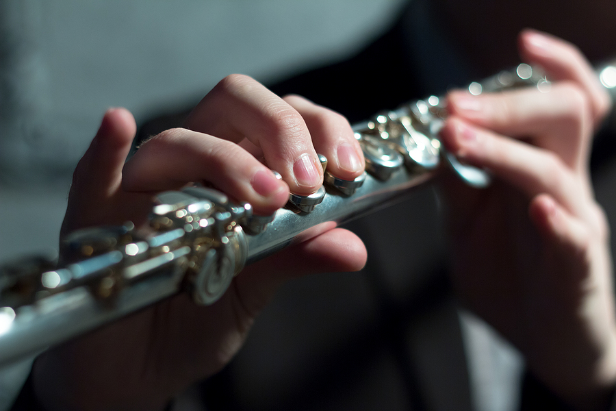 Closeup of playing flute