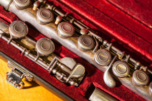Tarnished flute in red velvet case