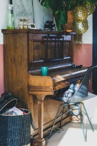 cluttered upright piano