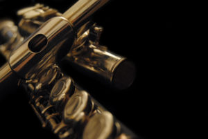 classical golden traverse flute on black background