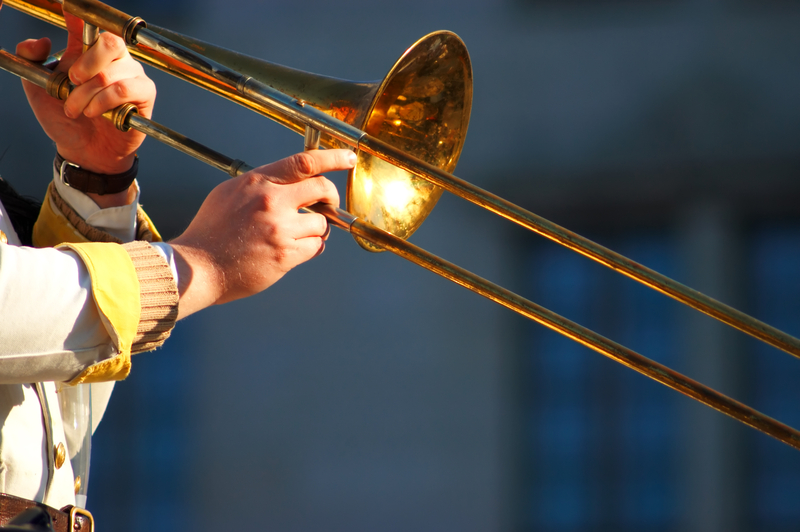 Side view of a trombone being played