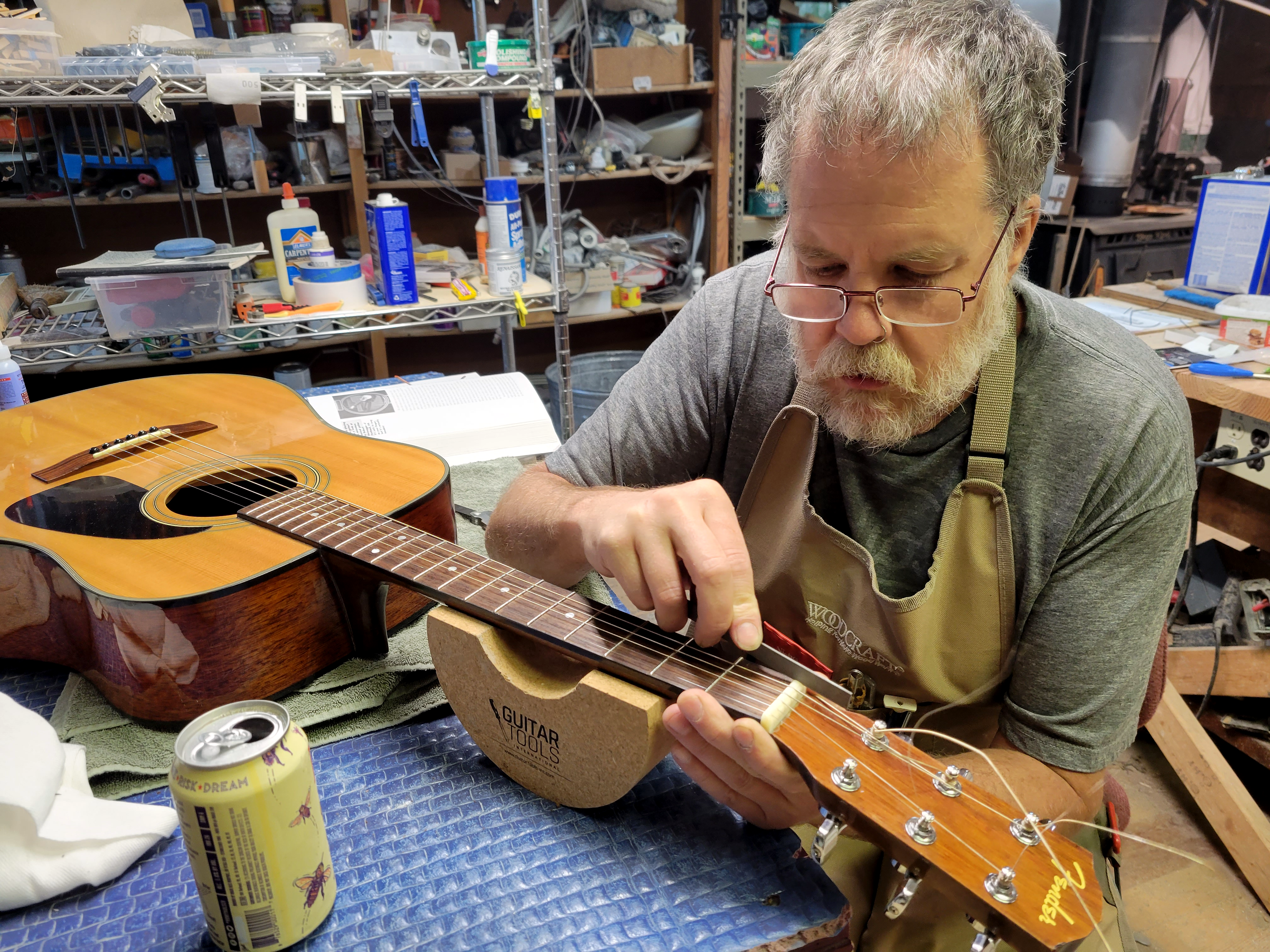 luthier working on guitar