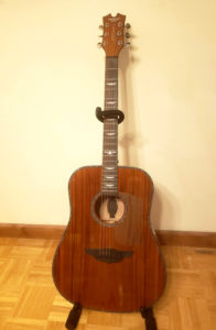 acoustic guitar standing upright